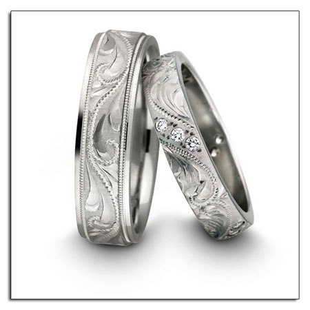 Engarved wedding bands by Novell.