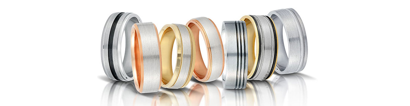 Novell wedding bands in pink, yellow and white gold.