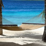 Caribbean honeymoon destinations - a beach hammock at Harbour Village in Bonaire.