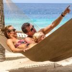 Caribbean honeymoon destinations - couple on beach at Harbour Village Bonaire