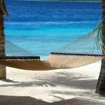 Caribbean honeymoon destinations - a beach hammock at Harbour Village in Bonaire.